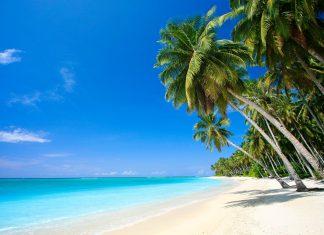 Die weit verstreuten Inseln des Funafuti-Atolls von Tuvalu im Südpazifik bieten Sonne, Strand, Meer und garantierte Abgeschiedenheit von jeglicher Zivilisation - © photogerson / Shutterstock