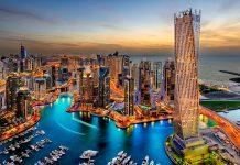 Der elegante 307 Meter hohe Cayan Tower in der Dubai Marina, VAE, ist der welthöchste Wolkenkratzer mit einer 90-Grad-Drehung - © Ashraf Jandali / Shutterstock